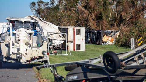 Overturned trailers sit along LA-46 after Hurricane Zeta on Oct. 29, 2020, in Reggio, La. A record seven hurricanes have hit the gulf coast in 2020 bringing prolonged destruction to the area. (Sandy Huffaker/Getty Images)