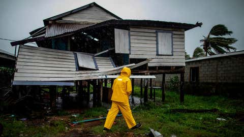 TOPSHOT - A man looks at a damaged house after the passage of Hurricane Iota, in Bilwi, Puerto Cabezas, Nicaragua, on November 17, 2020. - Storm Iota has killed at least nine people as it smashed homes, uprooted trees and swamped roads during its destructive advance across Central America, authorities said Tuesday, just two weeks after Hurricane Eta devastated parts of the region. (Photo by STR / AFP) (Photo by STR/AFP via Getty Images)