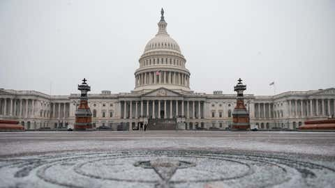 The U.S. Capitol is seen as a snow storm develops in Washington, D.C., on Dec. 16, 2020. (Andrew Caballero-Reynolds/AFP via Getty Images)