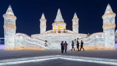 People look at ice sculptures at the Harbin Ice and Snow Festival in Harbin, in northeastern China's Heilongjiang province on Jan. 5, 2021. (STR/AFP via Getty Images)