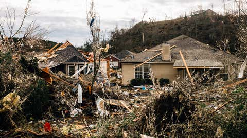 Fallen trees damage a property in the wake of a tornado on Jan. 26, 2021, in Fultondale, Ala. A tornado ripped through Fultondale damaging property and leaving one person dead and more than a dozen injured. (Wes Frazer/ Getty Images)