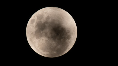 The moon is seen prior to the partial lunar eclipse from Sydney CBD on May 26, 2021, in Sydney, Australia. (Izhar Khan/NurPhoto via Getty Images)