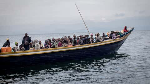 Goma residents are seen leaving on a boat on May 27, 2021. The authorities in Goma, in the east of the Democratic Republic of Congo (DRC), on Thursday morning ordered the evacuation of part of the city because of the risk of eruption of the Nyiragongo volcano, immediately causing the exodus of tens of thousands of people. (Guerchom Ndebo/AFP via Getty Images)