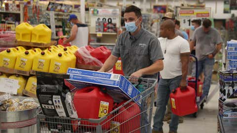 Evan Raggio and other people purchase supplies at the Stine hardware store before the possible arrival of Hurricane Laura on Aug. 26, 2020, in Lake Charles, La. Hurricane Laura is expected to hit somewhere along the Gulf Coast late Wednesday and early Thursday.  (Joe Raedle/Getty Images)
