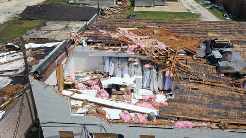 An aerial view from a drone shows clothing on racks of a businesses that's roof was ripped off as Hurricane Laura passed through the area on Aug. 27, 2020, in Lake Charles, La. (Joe Raedle/Getty Images)