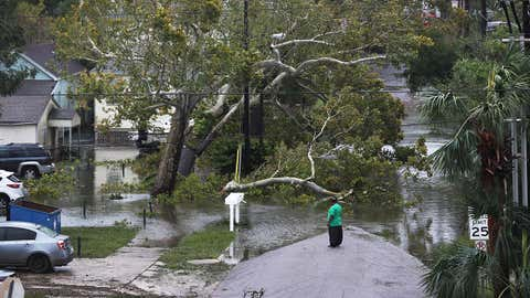 PENSACOLA, FL - SEPTEMBER 16: A person looks at a flooded neighborhood as Hurricane Sally passes through the area on September 16, 2020 in Pensacola, Florida. The storm is bringing heavy rain, high winds and a dangerous storm surge to the area. (Photo by Joe Raedle/Getty Images)