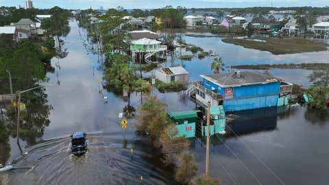 An aerial view from a drone shows a vehicle driving through a flooded street after Hurricane Sally passed through the area on Sept. 17, 2020, in Gulf Shores, Ala. The storm came ashore with heavy rain and high winds. (Joe Raedle/Getty Images)