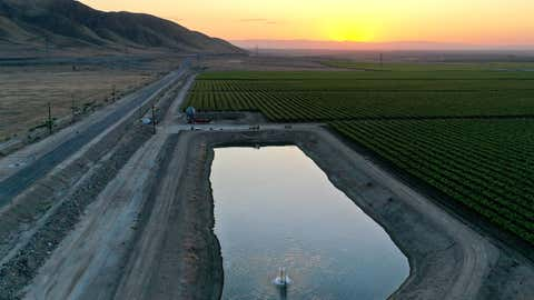 An aerial view as the sun sets beyond agricultural fields on April 21, 2021, near Bakersfield, Calif. California Gov. Gavin Newsom today declared a drought emergency in two counties following a winter with little precipitation. The order will allow the state to more quickly prepare for anticipated water shortages. (Mario Tama/Getty Images)