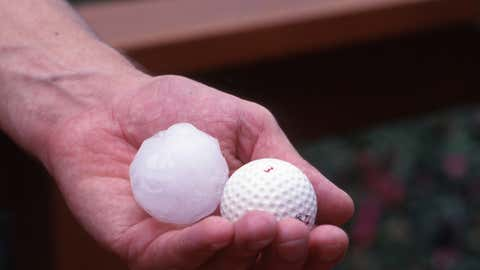 A hailstone bigger than a golfball that fell during a storm in Sydney causing widespread damage.