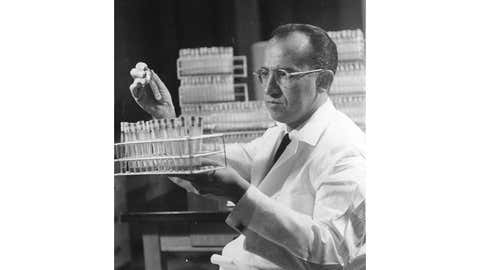 Dr Jonas Salk, who discovered the first vaccine against poliomyelitis, at work in the Virus Research Laboratory at the University of Pittsburgh Medical School.   (Photo by Keystone Features/Getty Images)