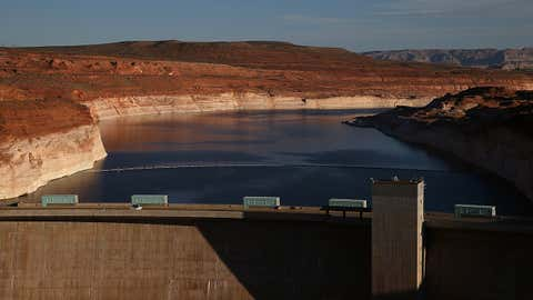 A tall bleached ''bathtub ring'' is visible on the rocky banks of Lake Powell at the Glen Canyon Dam on March 29, 2015 in Page, Arizona. The reservoir is at less than half its capacity. (Photo by Justin Sullivan/Getty Images)