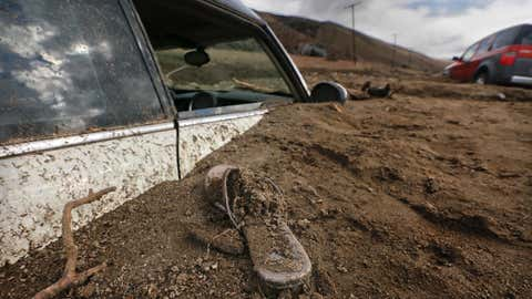 ELIZABETH LAKE ,CA., OCTOBER 16, 2015: A sandal is left behind  where a Mini Cooper is buried up to the windows in a mudslide on Elizabeth Lake Road October 16, 2015. One driver said there was a little bit of water on the road, then a wall of mud surrounded them (Mark Boster / Los Angeles Times ).