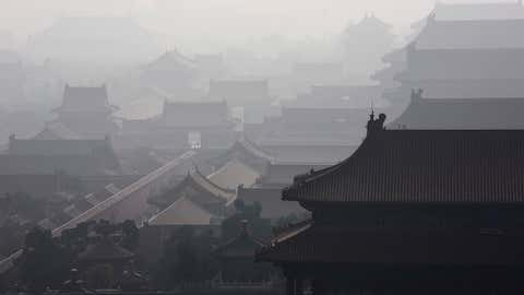 Haze from smog caused by air pollution hangs over the Forbidden City on November 15, 2015, in Beijing, China. As a result of industry, the use of coal, and automobile emissions, the air quality in China's capital and other major cities is often many times worse than standards set by the World Health Organization. (Kevin Frayer/Getty Images)