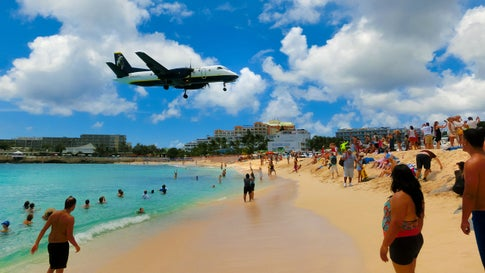 Maho Beach is located in St. Maarten, and famous for the Princess Juliana International Airport adjacent to the it. Arriving aircraft must touch down as close as possible to the beginning of Runway 10 resulting in aircraft flying over the beach at minimal altitude. (Marina113/Getty Images)