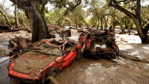 MONTECITO, CALIFORNIA JANUARY 9, 2018-Mangled cars are stuck near Olive Mill Road in Montecito after a major storm hit the burn area Tuesday. (Wally Skalij/Los Angeles Times)