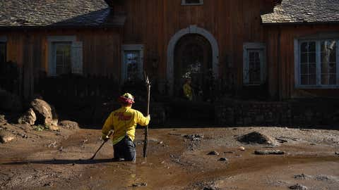 MONTECITO, CALIFORNIA JANUARY 10, 2018-Cal Firefighter Alex Jimenez marks the spot where he just found a body under the mud at a house along Glen Oaks Drive in Montecito after a major storm hit the burn area Wednesday. (Wally Skalij/Los Angeles Times)