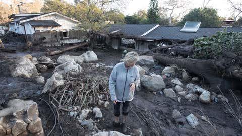 MONTECITO, CALIF. -- THURSDAY, JANUARY 11, 2018: Teresa Drenick looks over what is left of her sister Rebecca Riskin's home on Glen Oaks Drive along San Ysidro Creek in Montecito, Calif., on Jan. 11, 2018. Risking was killed in the mudslide. (Brian van der Brug / Los Angeles Times)