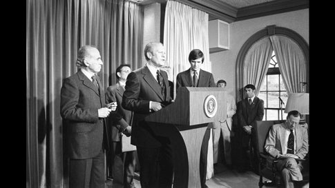 American politician US President Gerald Ford (1913 - 2006) (at lectern) announces a national swine flu immunization program in the White House Press Briefing Room, Washington DC, March 24, 1976. Among those with him are virologist Dr Jonas Salk (1914 - 1995) (left) and US Secretary of Health, Education, and Welfare F David Mathews (center). (Photo by Ricardo Thomas/Gerald R Ford LIbrary/PhotoQuest/Getty Images)