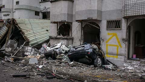 Damaged cars are seen after an earthquake struck on February 8, 2018 in Hualien, Taiwan. The 6.4 magnitude earthquake hit late Tuesday night. According to reports, six people have been killed with hundreds injured. Almost 100 weaker earthquakes were detected along Taiwan's east coast in the last week. (Billy H.C. Kwok/Getty Images)