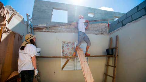 NGO Batisseurs Solidaires members rebuild a house destroyed by the hurricane Irma, in Quartier d'Orleans on February 28, 2018, on the French overseas island of Saint-Martin six months after the passing of Hurricanes Irma and Maria in September. (Lionel Chamoiseau/AFP/Getty Images)