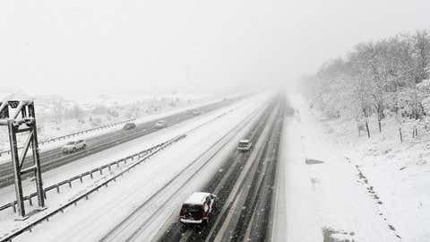 Cars travel on Interstare 50 westbound in Prince George's country as a late March snow storm hits the Washington D.C. region. (Jonathan Newton/The Washington Post via Getty Images)