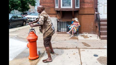Eduardo Velev opens a fire hydrant during a heatwave on July 1, 2018 in Philadelphia, Pa. An excessive heat warning has been issued in Philadelphia and along the East Coast as hot and humid weather hits the region this week.  (Jessica Kourkounis/Getty Images)