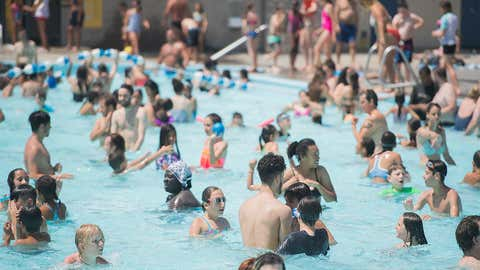 People cool down in a public pool in Montreal, Thursday, July 5, 2018. (Graham Hughes/The Canadian Press via AP)