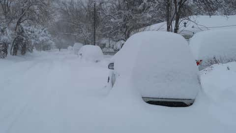 Snow is piled high on vehicles parked on a road in Boulder, Colo., which received 22 inches by Tuesday morning, Nov. 26, 2019. (weather.com/Bob Henson)