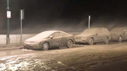 Windblown sand mixed with rain from the weekend nor'easter blasted cars along the Massachusetts coast. This was on Winthrop Shore Drive in Winthrop, Massachusetts. (Kirill Gusev)