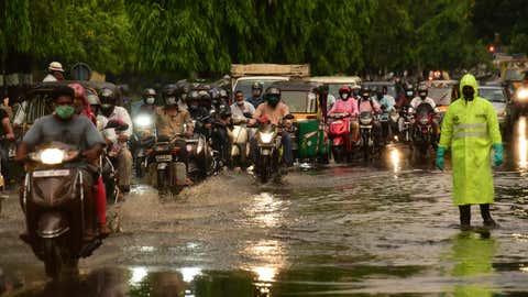 Motorists wade through a waterlogged Raj Bhavan Road in Hyderabad, Telangana on April 20, 2021. (Rama Moorthy P/BCCL Hyderabad)