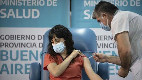 Doctor Estefania Zeurnja receives a dose of a COVID-19 vaccine at the Dr. Pedro Fiorito Hospital in Avellaneda, Argentina, on December 29, 2020. (Xinhua/Martin Zabala/IANS)