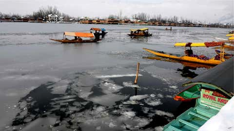 The frozen Dal lake in Kashmir valley on January 11.