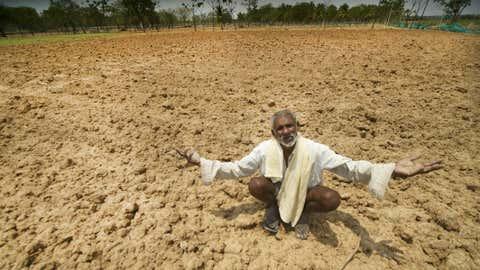 File photo of a 60-year-old farmer, Kulla Shetty, sitting in the middle of his dried agriculture land cursing the rain god near Mysuru, Karnataka (Netra Raju and S Nagendra / BCCL)