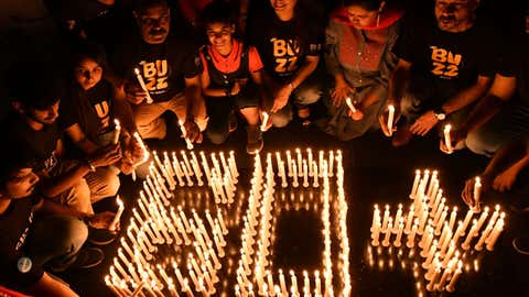 Members of the World Wide Fund for Nature (WWF) in Bhopal, Madhya Pradesh create a 60+ sign using candles to stress the importance of observing Earth Hour for longer than 60 minutes. (A Moeed Faruqui/BCCL Bhopal)