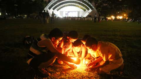 A group of children light candles to observe Earth Hour at the Durbar hall ground in Kochi, Kerala. (Ashish K Vincent/BCCL Kochi)