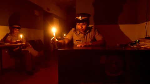 Police officers observe Earth Hour while on duty at the women's police station in Kozhikode, Kerala. (E Gokul/BCCL Kozhikode)
