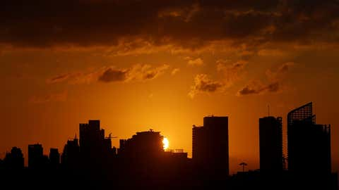 Photo taken on September 13, 2020, shows the city view in sunset glow in Beirut, Lebanon.