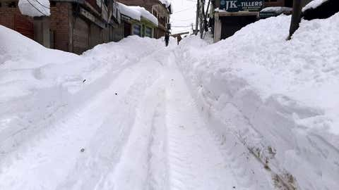 Heavy snow covers roads in Kashmir.