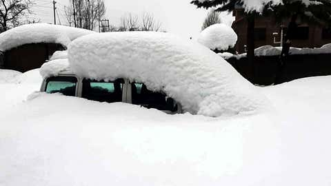 A car trapped under the thick blanket of snow in the Shopian area of South Kashmir on January 6.