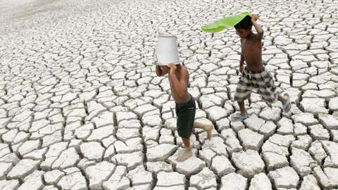 Boys walk on parched land near Barberia on the outskirts of Kolkata, West Bengal. (Kamalendu Bhadra/TOI, BCCL, Kolkata)