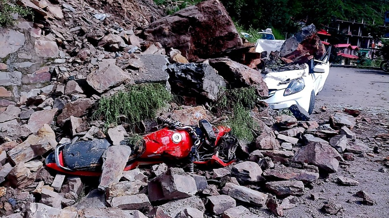 The falling rocks hit a car and two motorcycles, plunging the vehicles into an almost 500-metre-deep valley.