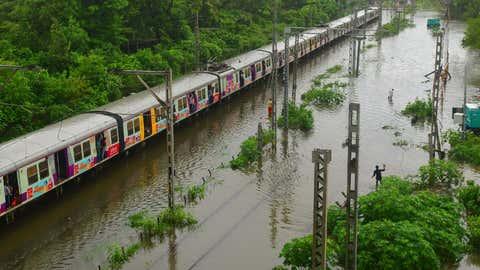 Heavy rainfall waterlogged tracks of harbour line trains between Kurla and Tilak Nagar. (Sanjay Hadkar/TOI, BCCL, Mumbai)
