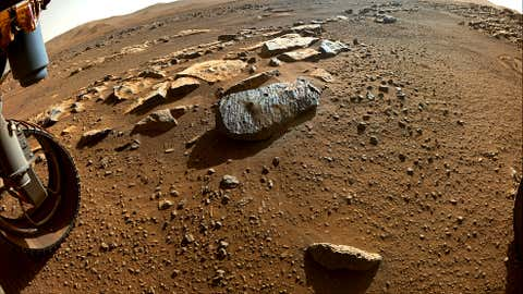 """Two holes are visible in the rock, nicknamed """"Rochette,"""" from which NASA's Perseverance rover obtained its first core samples. (NASA/JPL-Caltech)"""
