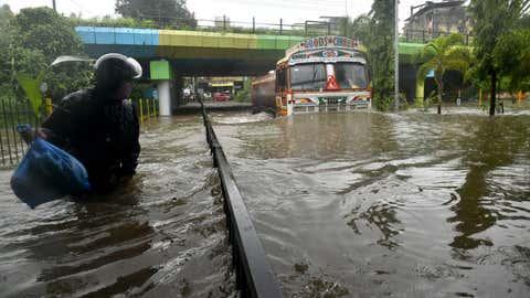 A heavy vehicle finds its way through the flooded streets of Mumbai. (KK Choudhary/TOI, BCCL, Mumbai)