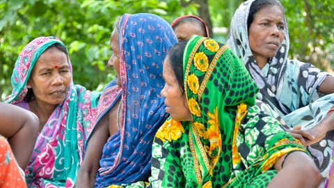 Women are part of the forest management committees formed under the FRA. Seen here are women from a village in Odisha discussing the various MFP collected and its uses. (Akoijam Sunita / Oxfam India)