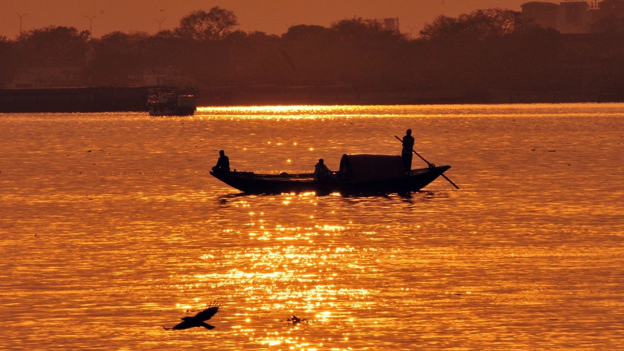 The Hooghly river bathed in golden light. The 260-km Hooghly is an arm of the Ganga, and empties into the Bay of Bengal. The British East India Company sailed up this river set up Calcutta (now Kolkata), a colonial city, which served as British India's capital from 1772 to 1911.  