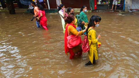 Waterlogging made it difficult for commuters at Bhandup. (Sanjay Hadkar/TOI, BCCL, Mumbai)
