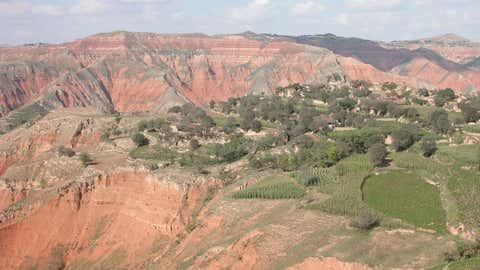 Cenozoic red deposits of the Linxia Basin in Gansu Province, northwestern China. (Tao Deng)