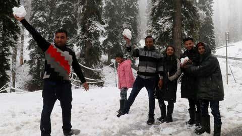 Tourists enjoying the first snowfall at the world-famous tourist resort in Gulmarg. (Credits: Bilal Bahadur/TOI, Delhi, BCCL)