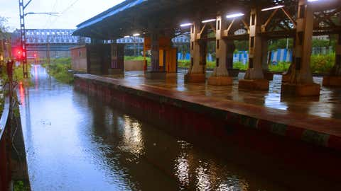 Trains were disrupted during nighttime till morning waterlogged during heavy rainfall at Nahur station at Central side in Mumbai. (Sanjay Hadkar/TOI, BCCL, Mumbai)